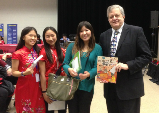 Young journalist (from left) Michelle Zeng, Gratiana Chen  and Editor-in-Chief Joanna Liu taking a photo with  Oakville Mayor, Rob Burton.